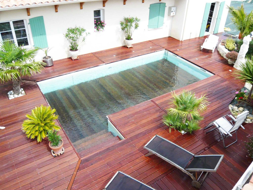Le plancher mobile transformez votre piscine en terrasse for Piscine couverture mobile